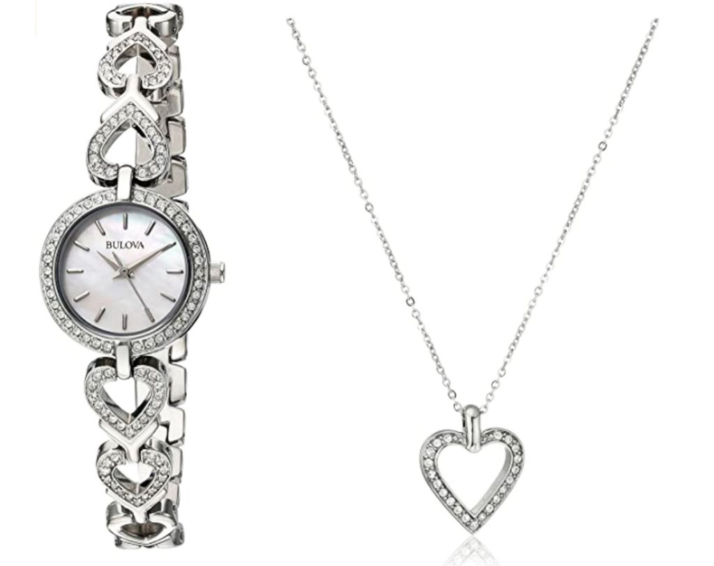 silver watch with crystals and a watch band made of hearts plus a matching crystal heart necklace next to it