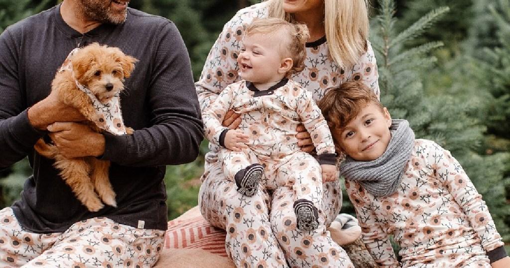 famlily sitting outside wearing Burt's Bees reindeer pajamas