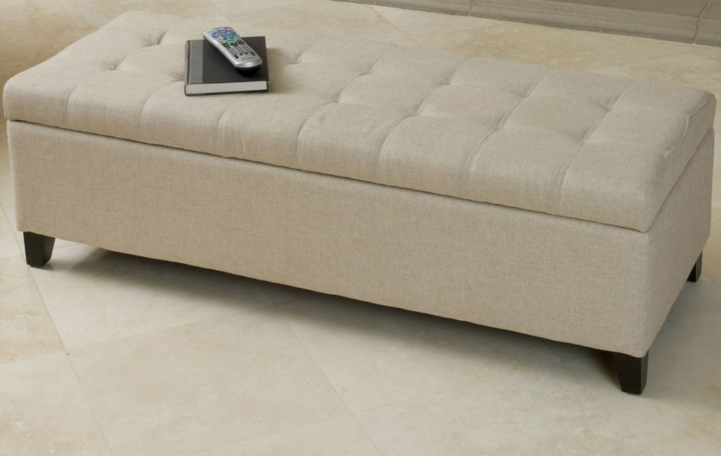 storage ottoman with a remote on it