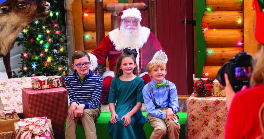 group of kids taking photo with Santa in store