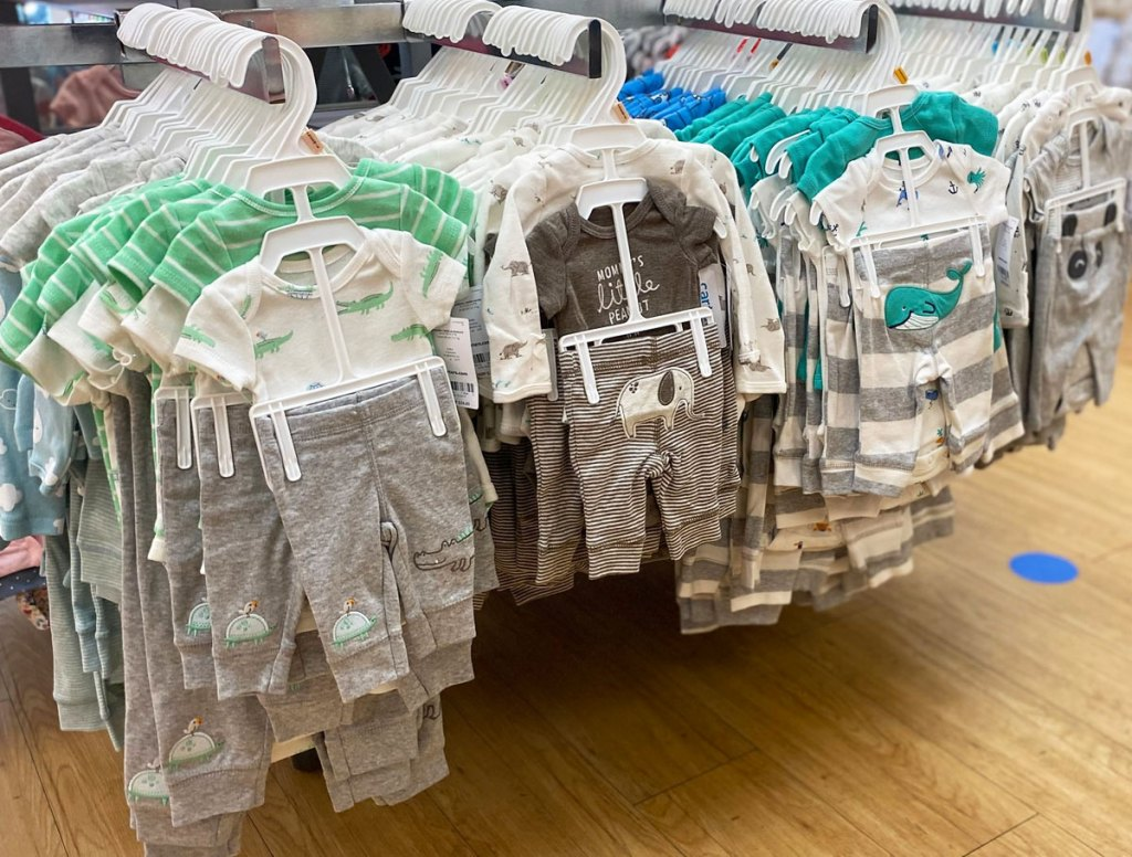 carters 3-piece baby outfit sets on store display racks