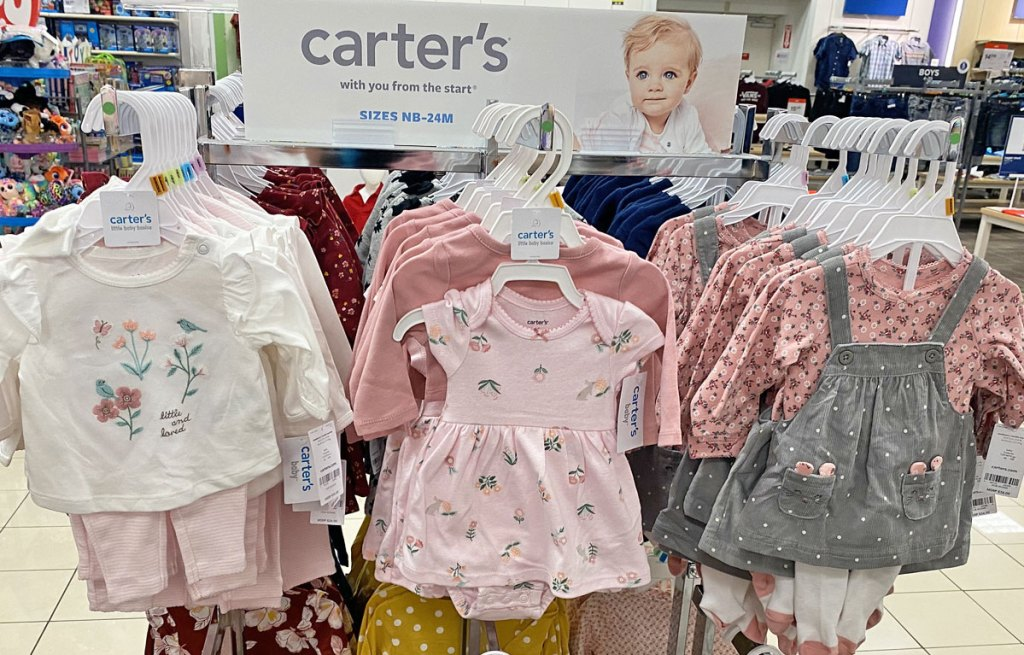 carter's baby girl clothing sets on store display