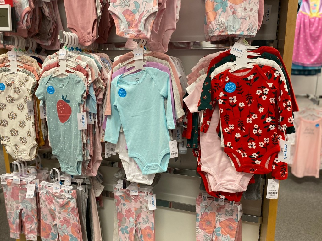 Carter's Bodysuit Sets hanging in store