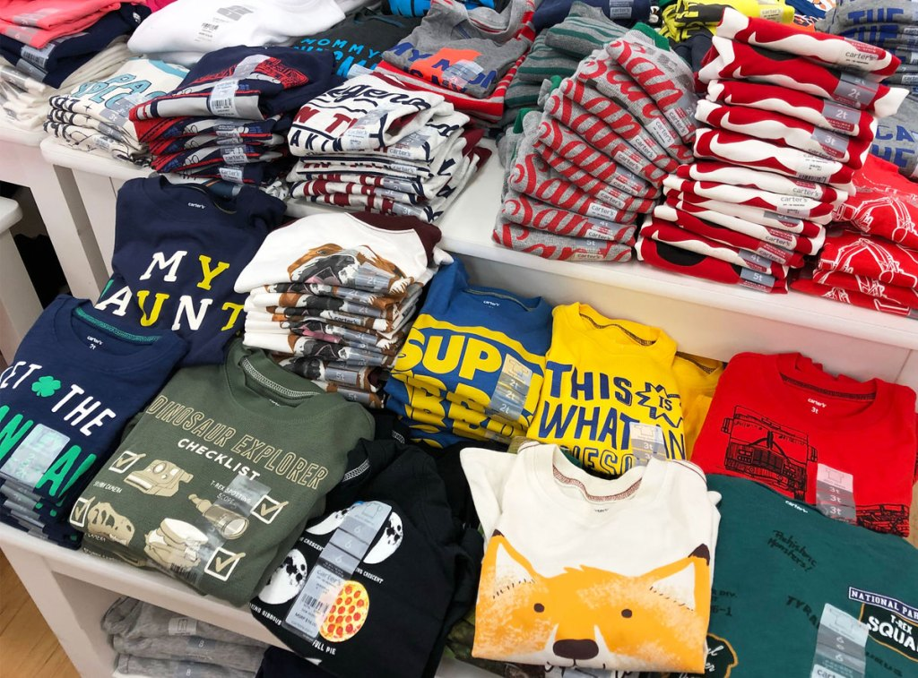 Display table full of folded boy's graphic tees