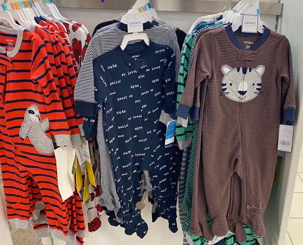 animal theme carter's baby sleep and play on store display
