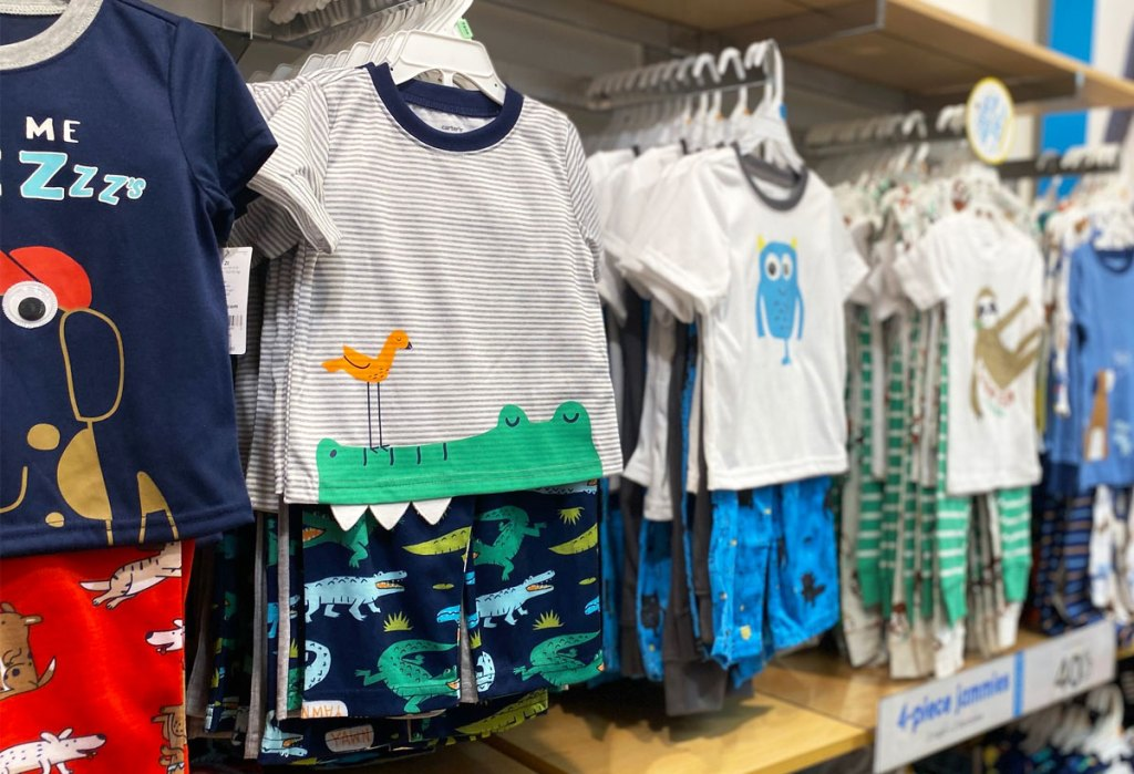 carter's toddler boys graphic pajama sets on display in store