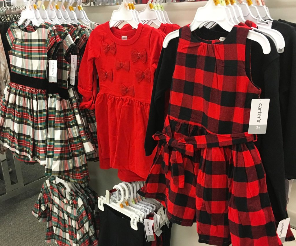 toddler girls christmas dresses hanging on store display
