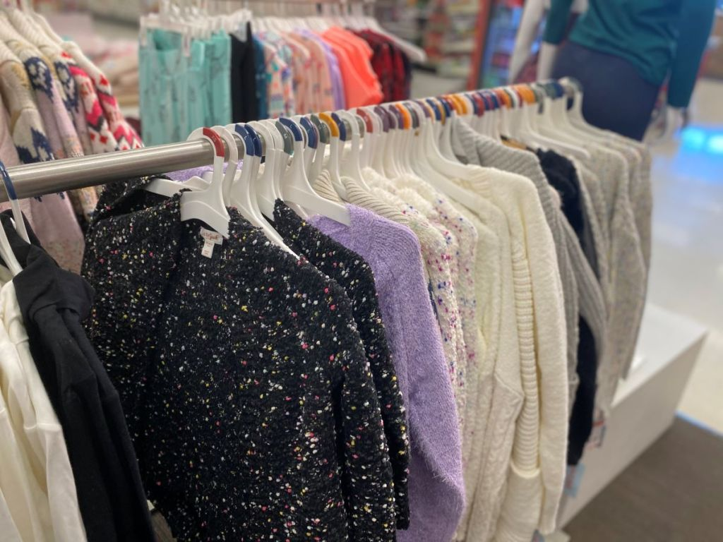 sweaters on hangers at Target