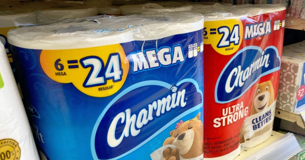 two packages of toilet paper on shelf