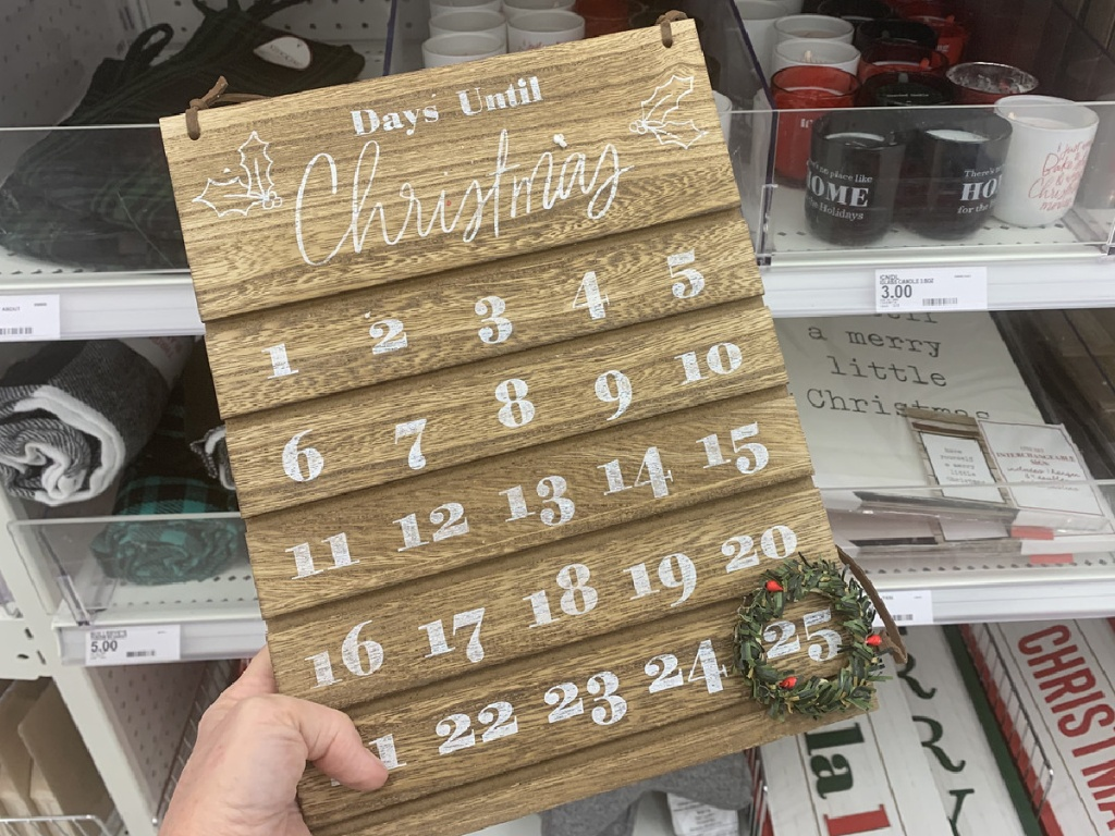 hand holding wooden calender for December and Christmas