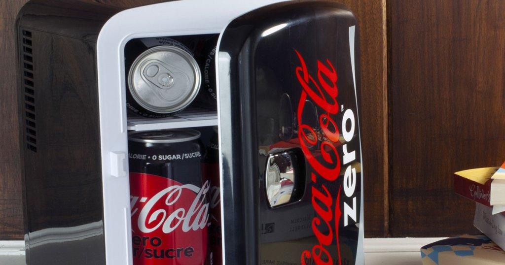 black coke zero mini fridge opening to show cans of coke zero inside