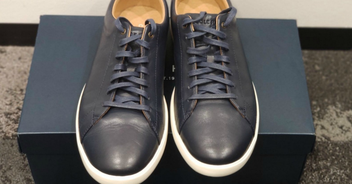 pair of mens dress shoes sitting on shoe box