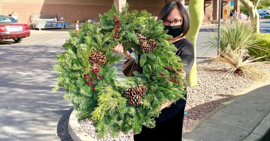 WOman holding Costco large fresh wreath