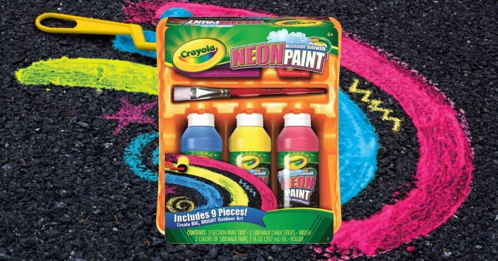 Crayola brand paint kit near a painted driveway