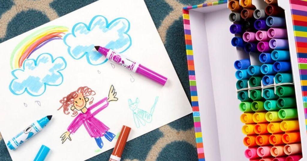 mini marker set next to kids drawing