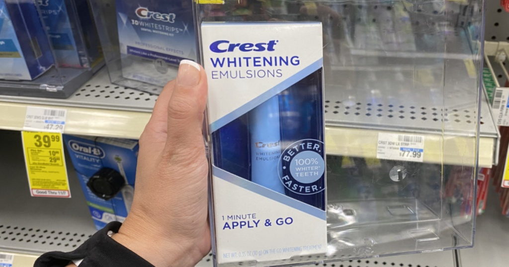 hand holding crest whitening product
