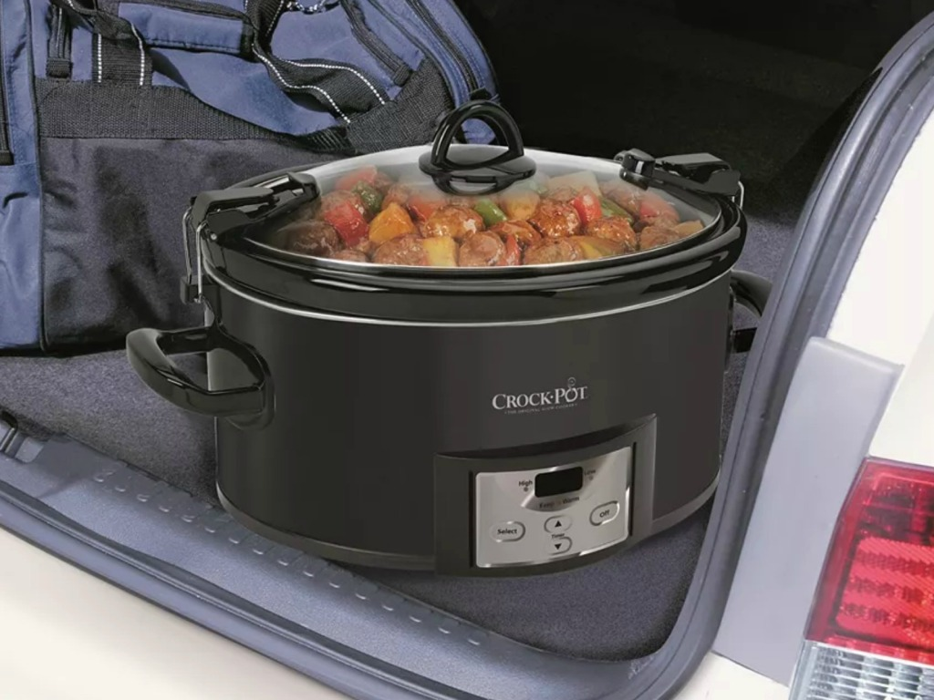 A large slowcooker in an open trunk