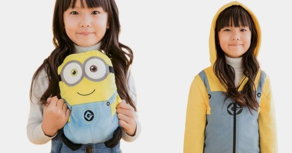 two girls one with a plush minion and one in a sweatshirt