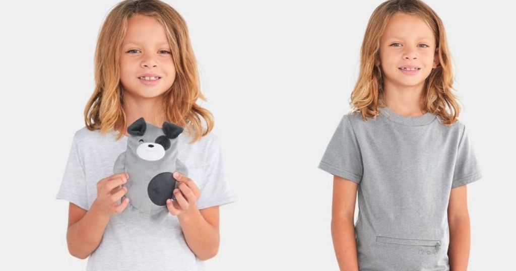 child holding a plush dog next to a child in a t-shirt