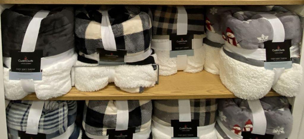 Cuddl Duds blankets on a shelf