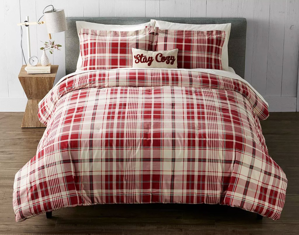 red and white plaid comforter set on a bed with matching pillow shams and coordinating throw pillow
