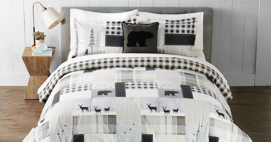 white and grey bear print comforter set on a bed with matching pillow shams and coordinating throw pillow