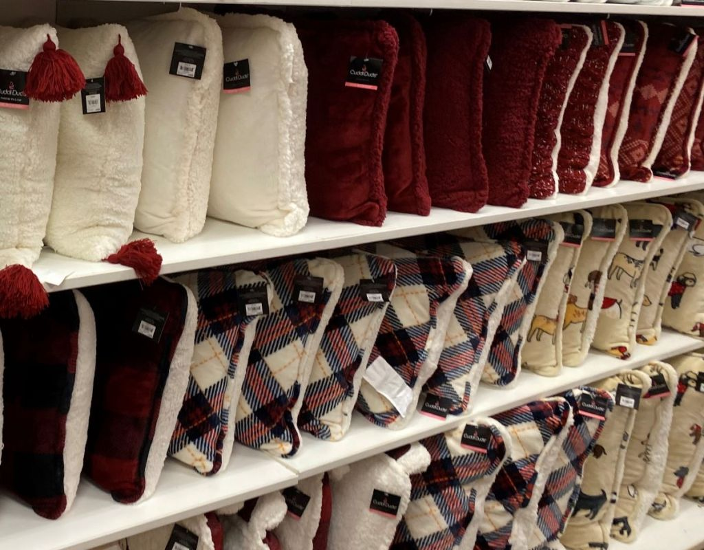 display of Cuddl Duds pillows