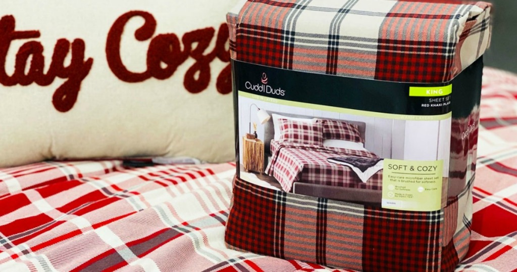 Cuddl Duds brand sheets on a made store display bed