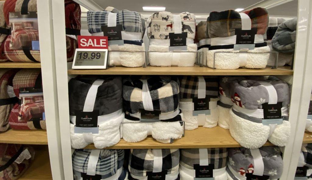 display of Cuddl Duds blankets at Kohl's