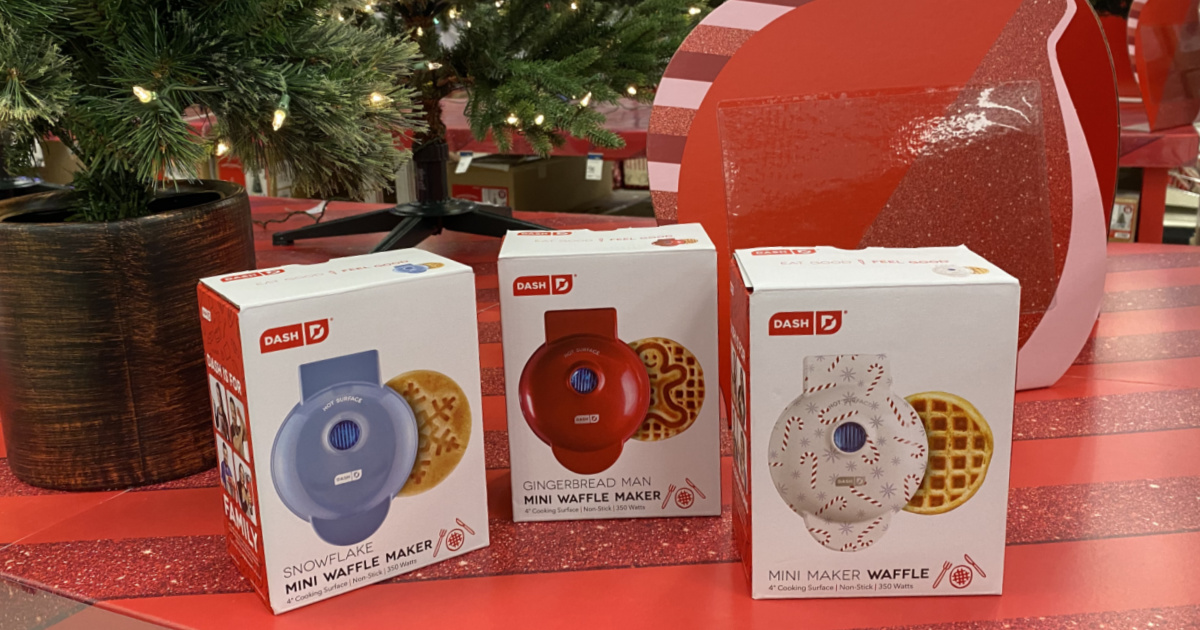 three seasonal mini waffle makers on table with ornament decoration and artificial Christmas trees