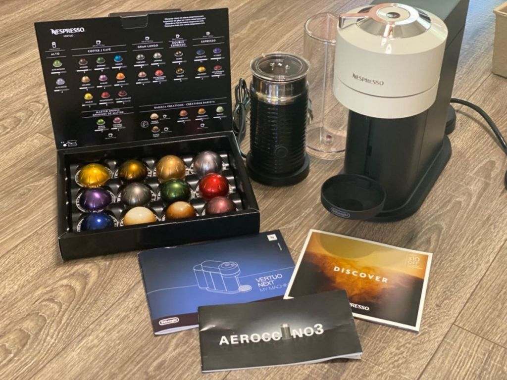 Nespresso Virtuo with frother and box of pods