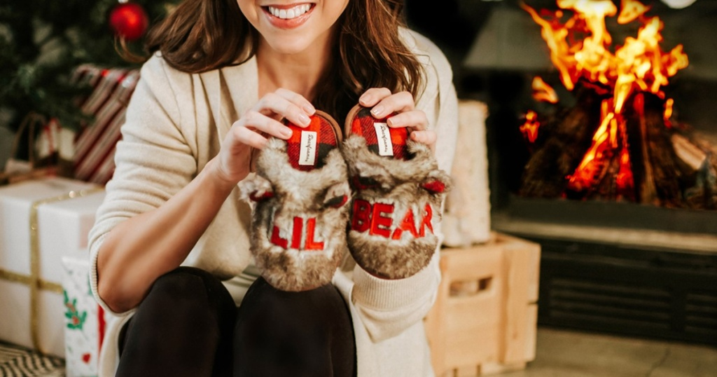 woman holding fuzzy lil bear scuff slippers