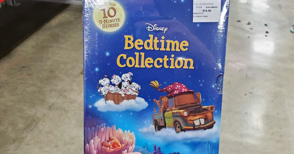 person holding up blue box of disney bedtime collection book set at sam's club