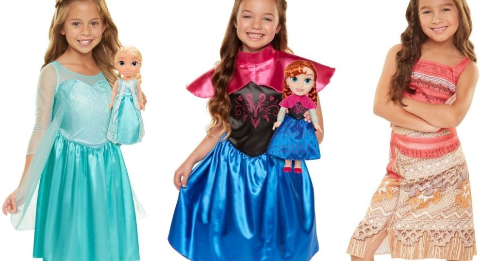 girls wearing Disney Princess dresses and a doll
