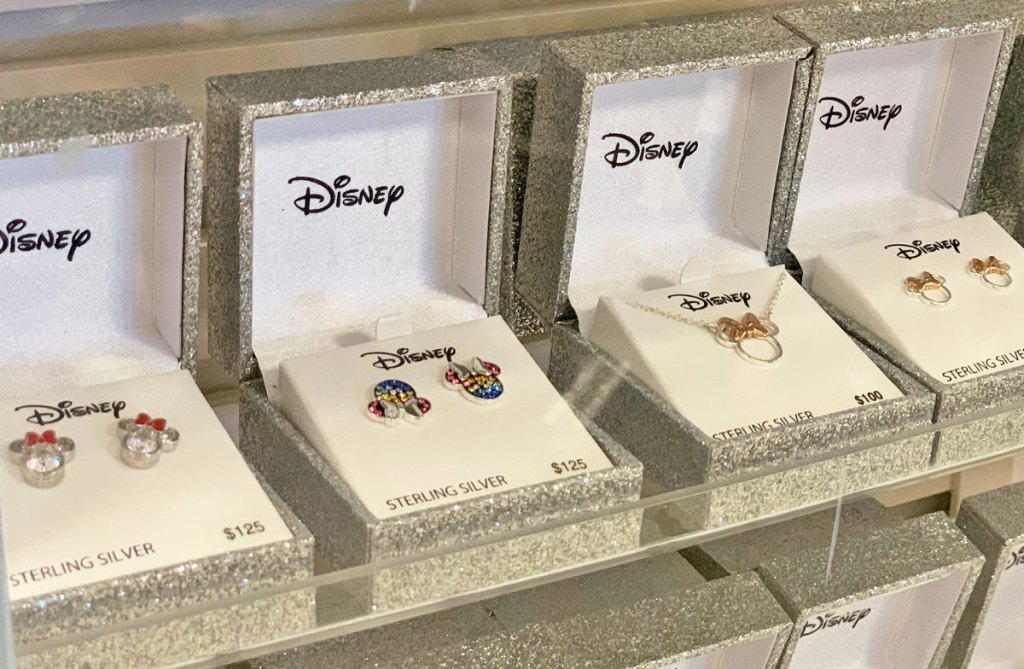 various disney minnie and mickey mouse shaped earrings and necklaces in sparkly silver jewelry boxes