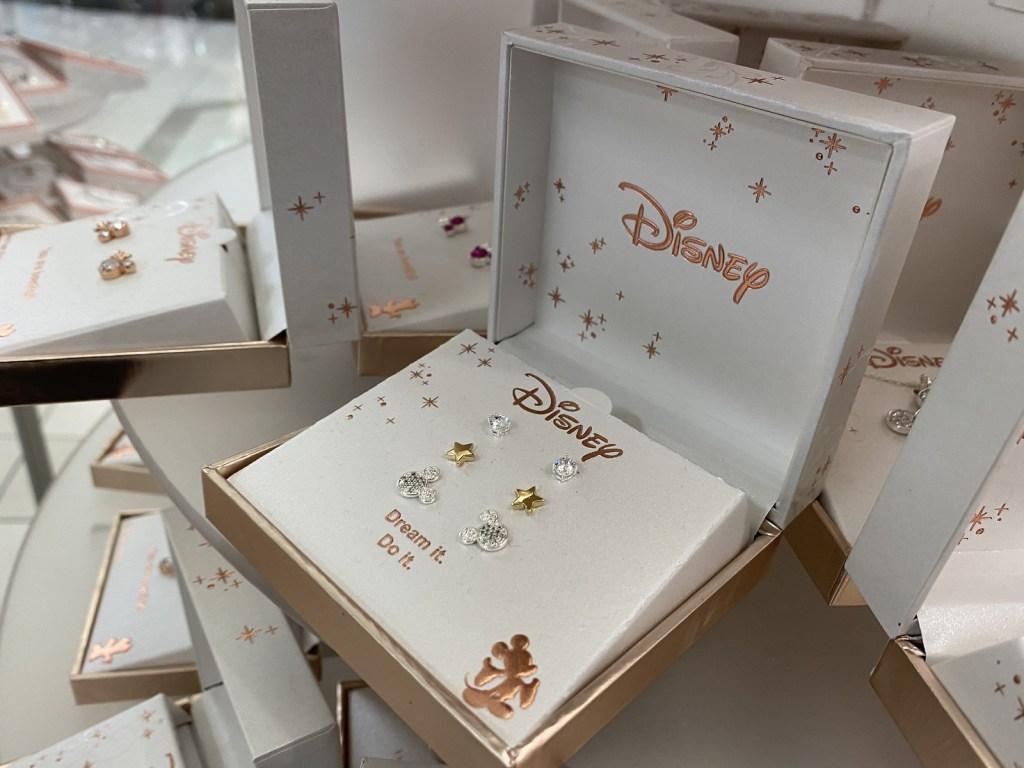 Disney Earrings shown inside store