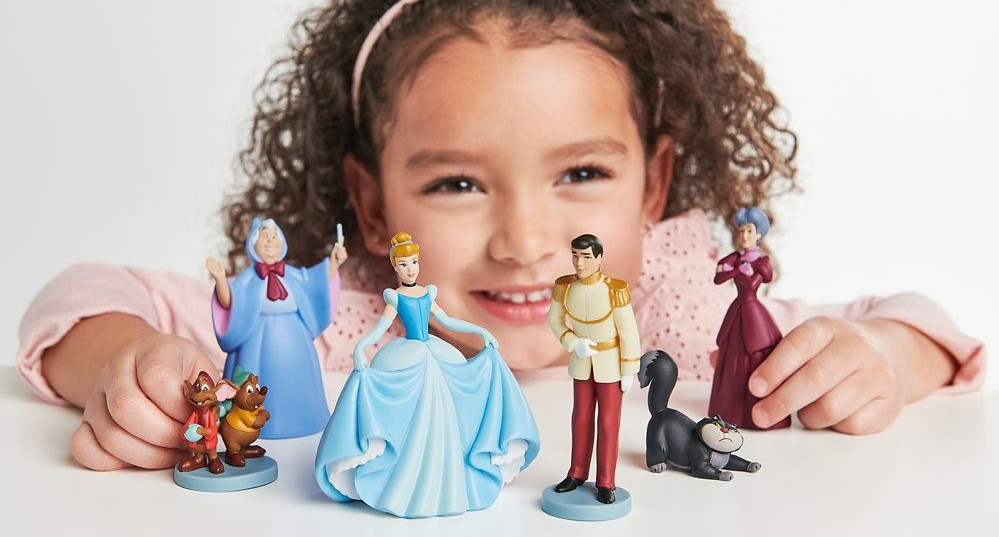 girl playing with Cinderella figures