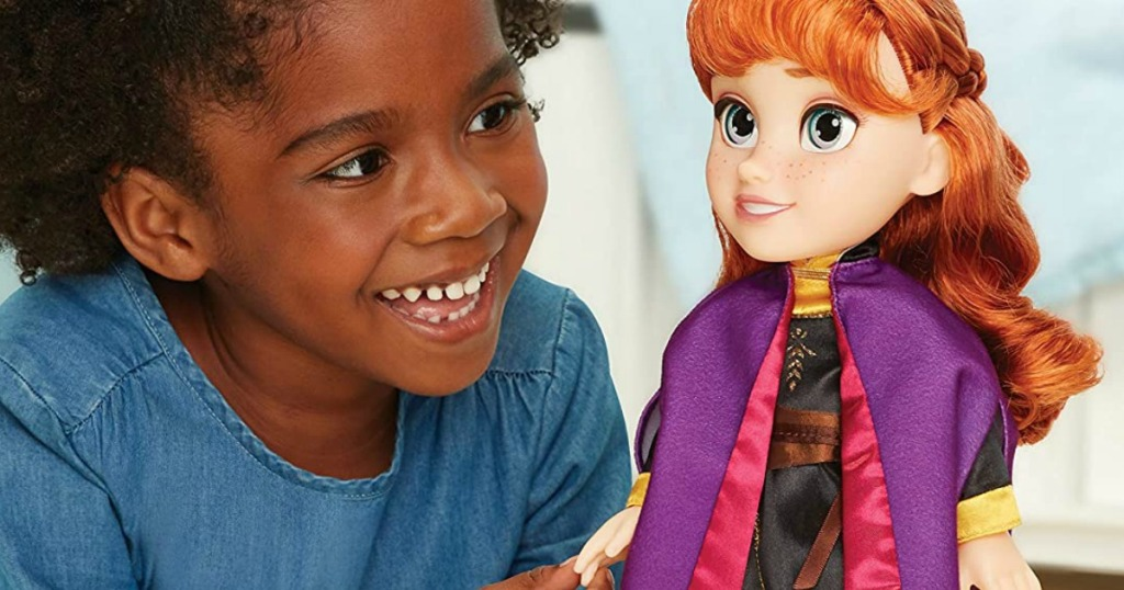 Disney Frozen 2 Anna Travel Doll and little girl