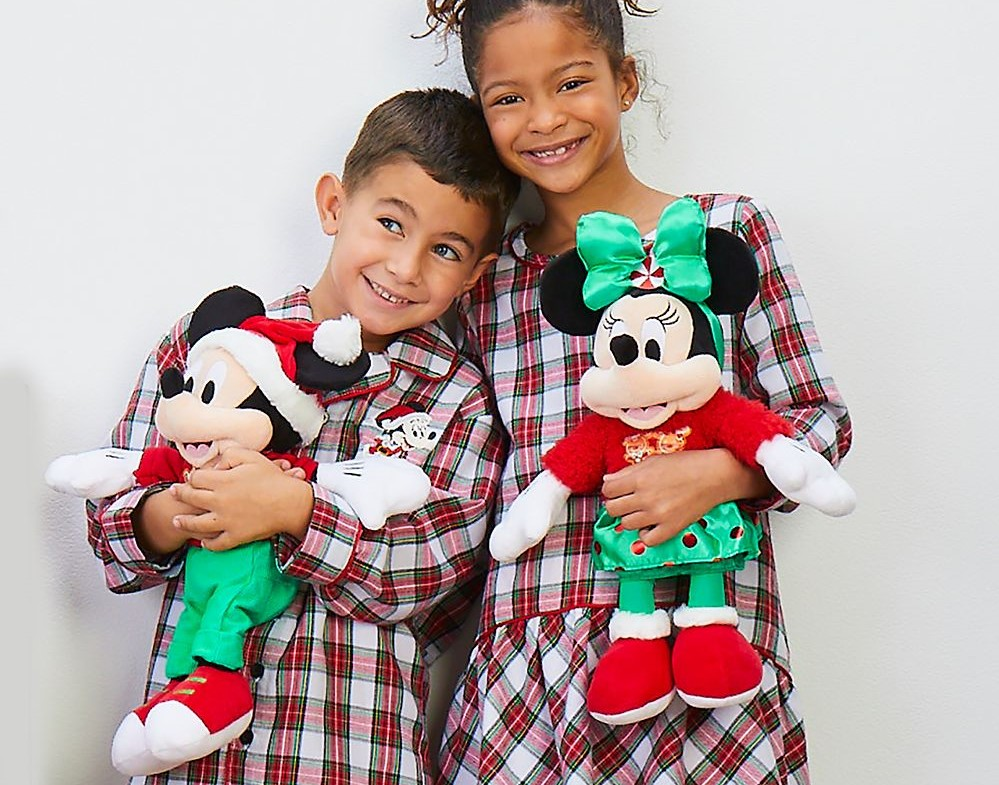 boy and girl holding plush Mickey and Minnie