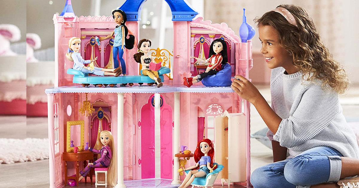 girl playing with a pink and blue disney princess castle