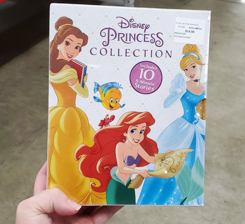 woman holding up disney princess collection book set at sam's club