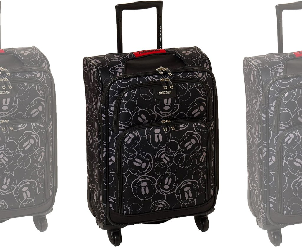 black softside luggage with mickey mouse head outlines printed allover