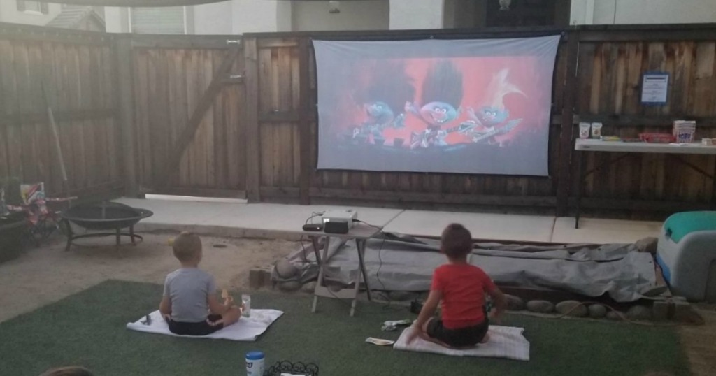kids watching a movie n a projector screen