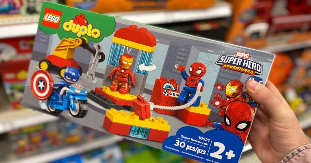 hand holding lego duplo marvel set