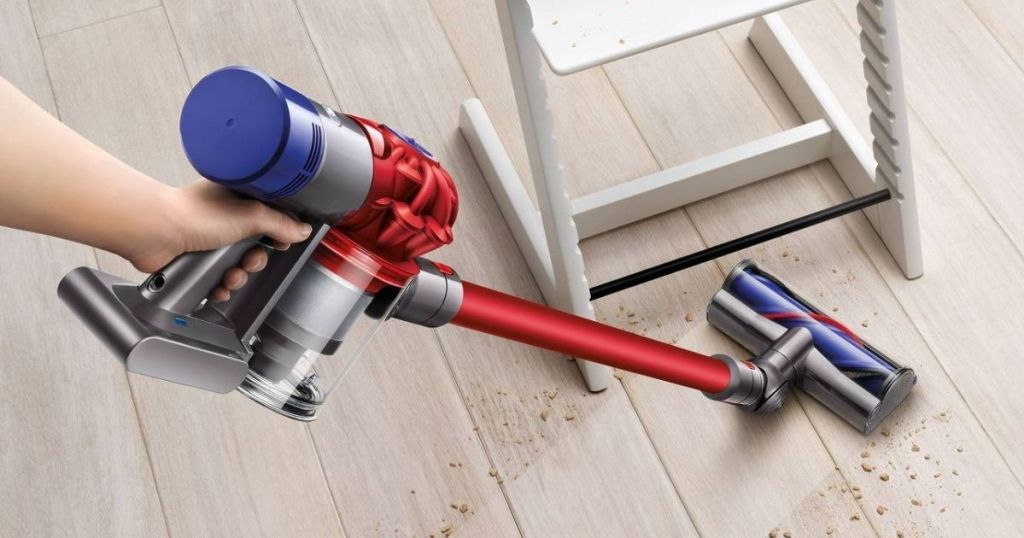 Dyson Motorhead 8 Stick Vacuum being used to vacuum up crumbs