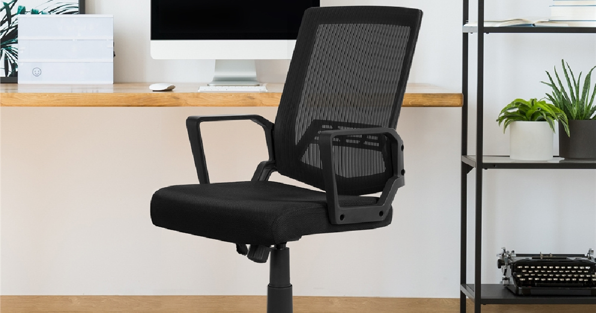 black mesh office chair in front of computer and desk