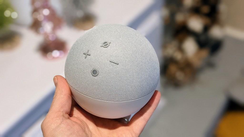 Hand holding echo dot speaker