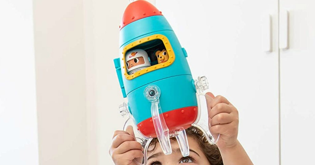 kid playing with an educational rocket ship