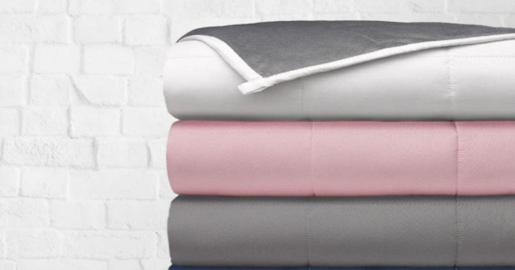 stack of folded weighted blankets
