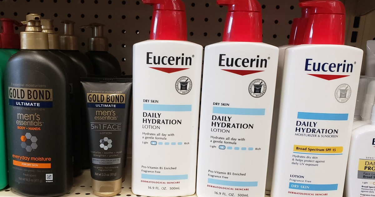multiple bottles of eucerin lotion sitting on a store shelf